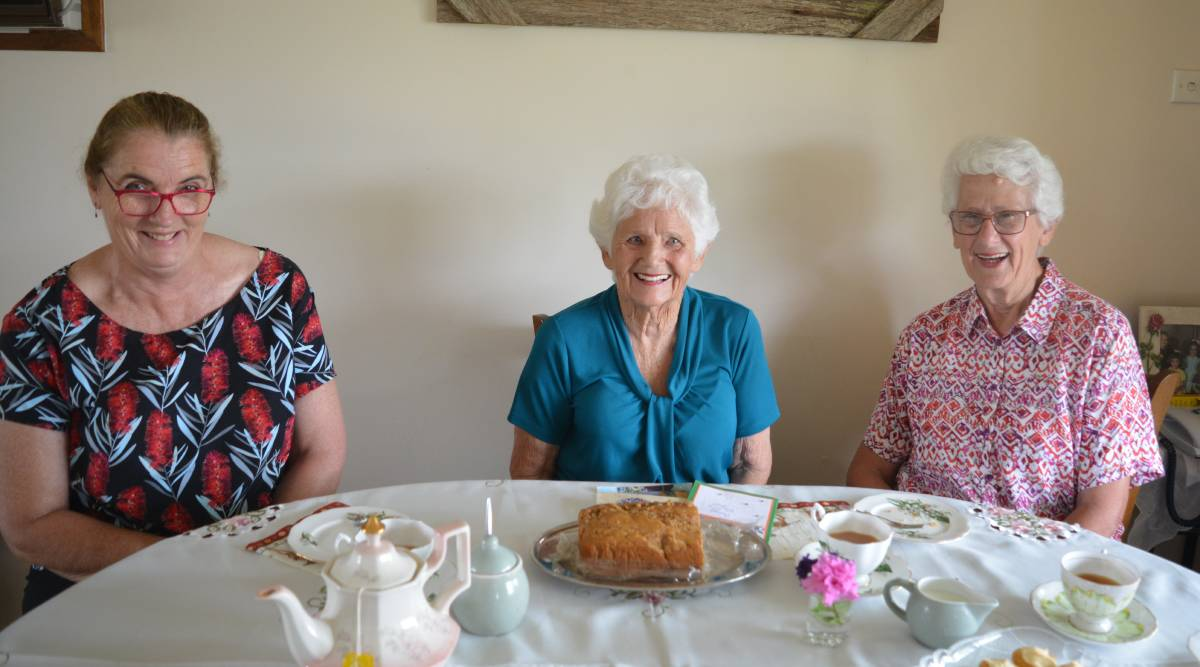 Dot Stokes, Elaine Maslen and Leonie Benson enjoy a cuppa, a slice of cake and a chat. Photo Anne Keen