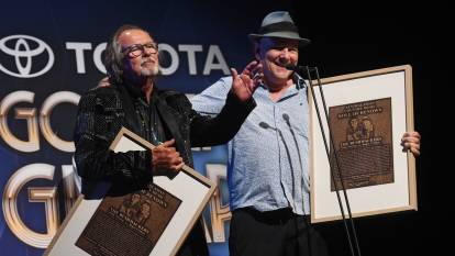 HONOURED: The Bushwackers' Dobe Newton and Roger Corbett receiving their Australasian Country Music Roll of Renown awards at the Golden Guitars on Saturday night. Picture: Gareth Gardner