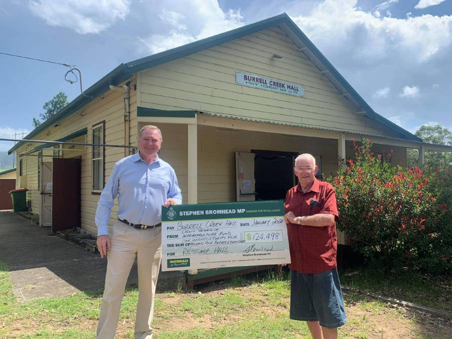Funding: Stephen Bromhead presenting a cheque for $124,498 to a representative of Burrell Creek Hall. Photo: Supplied
